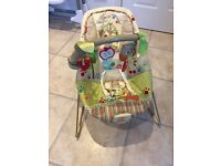 Fisher price woodland bouncy chair with calming vibrations.