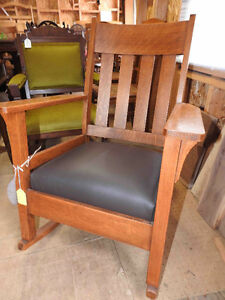 several different antique arts and craft chairs and rockers