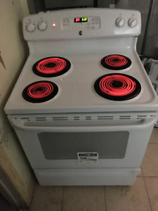 An yr old GE stove with warranty for sale