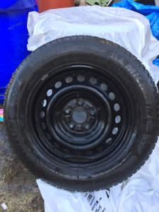 """4 pneus d'hiver 16"""" sur jantes. Michelin X-ice, 9/32 d'usure"""