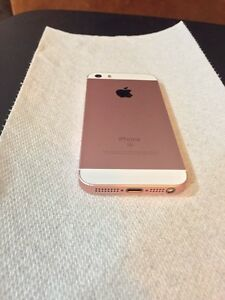IPHONE SE - ROGERS ** UNDER WARRANTY** London Ontario image 6