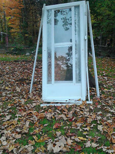 2- 36 INCH SCREEN DOORS WITH FRAMES 25.00 EACH OR BOTH For 40.00