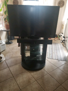 TV, stand and sound bar