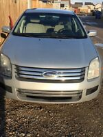 Low low Kms Ford Fusion 2006 v6 clean car in side out