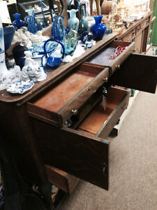 Antique oak hutch with oval mirror