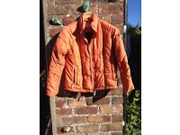 Ladies orange Musto jacket, size 10