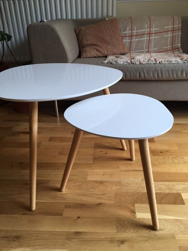 Two Modern White Scandinavian Style Nesting Coffee Or Side Tables With Light Wood Legs In