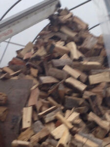 dry firewood stored inside, free delivery