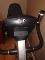 Exercise bike with back support