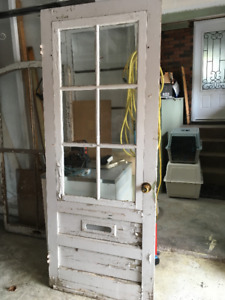 vintage solid wood door with sectioned glass insert