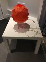 IKEA white lack table and orange lamp