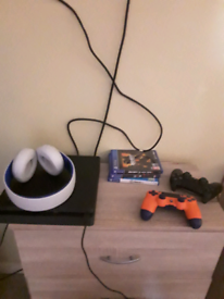 Ps4 slim with 3 games, 2 wireless pads and headset