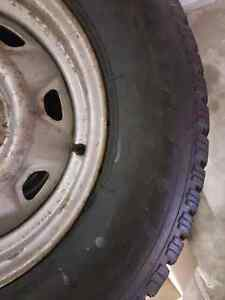 Studded Winter Tires 215/70R14 on 5 bolt Ford rims Prince George British Columbia image 7