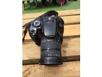 Canon 400D with big battery pack, Sigma DC 17-70MM, charger + 2Gb CF card