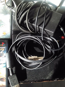 Ps2 console and wheel and games