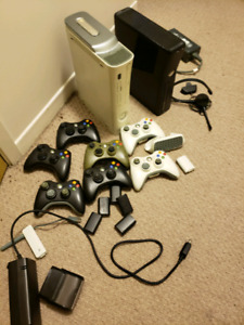 2 Xbox with controllers and accessories