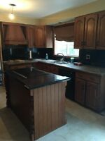 Solid Oak Kitchen Cabinets and granite tops
