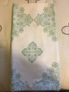 White curtains with teal decals