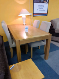 Beautiful pine table with 4 cream material chairs