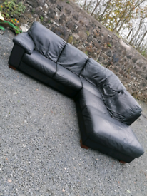 Black leather corner sofa. Delivery available.
