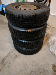 "4 Michelin X-Ice winter tires with 10/32"" tread (35/70R14)"