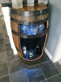 Bespoke half whiskey barrel drinks cabinet. Ideal for mancave! 🍻🥃