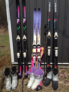 3 sets of downhill skis and boots