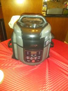Ninja foodie pressure cooker with tender crisp