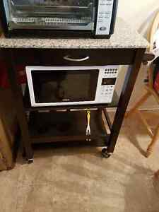 Microwave stand with storage and granite top.
