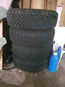 4 New Goodyear Ultra Grip Winter Tires with rims