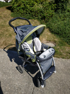 Baby Stroller and Assorted Baby Clothes