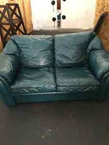 Perfect condition green leather couches