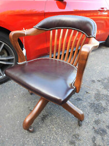 several different antique vintage office  chairs in new leather