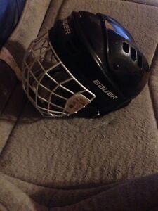 Black Bauer kids size medium hockey helmet with cage  Regina Regina Area image 2