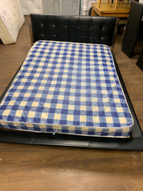 33. Black leather and chrome double bed and mattress