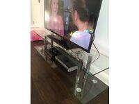 Glass TV entertainment unit