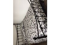 Black metal frame double bed