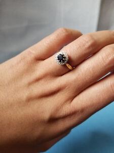 9 carat yellow gold. diamonds .sapphire ring.