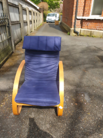 65. Blue material and wood armchair