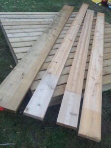 Quick sale 2 - 2x8 pressure treated wood 12 ft long