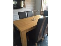 Oak table and 6 chairs (brown)