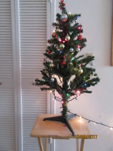 4 Feet Christmas Tree with Decor/lighting and stand for $ 25/OBO