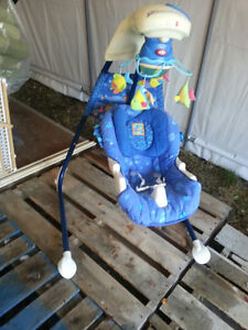 Baby swing w/mobile/music/differing speeds/switch seat position