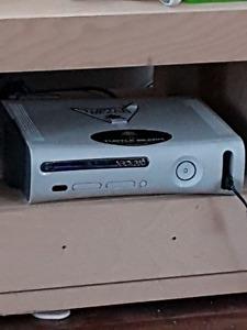 Xbox 360 1 manette et 4 jeux négociable