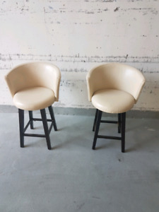 2 Cream Leather Swivel Chairs