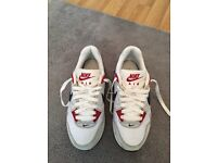 Size 4 Nike air trainers