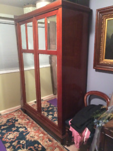 Antique Mahoghany & Mirrored Armoire. Comes apart.