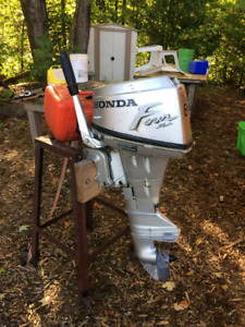 2 outboards left honda and evinrude