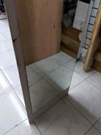 Mirror on a wooden board door