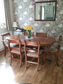 Yew extending dining table and 6 chairs